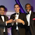 Dr Venky Dubey, PhD student Neil Vaughan, and awards host and former Apprentice winner Tim Campbell with the trophy.
