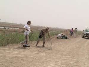 BU researchers assess mass graves, South of Baghdad, 2003.