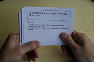 Gail Ollis uses cue cards with questions to gain insight into programmer's behavioural choices in coding in a team environment.